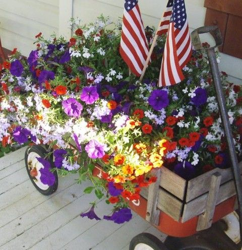 98f476121 Flowers in an old red radio flyer wagon