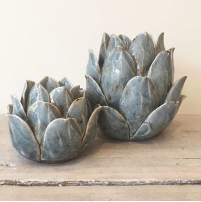 Contemporary ceramic artichoke tea light holder with a lightly distressed finish. Available in duck egg or white. Small size: 9cm high by 11 cm wide   Large size: 15cm high by 20cm wide.