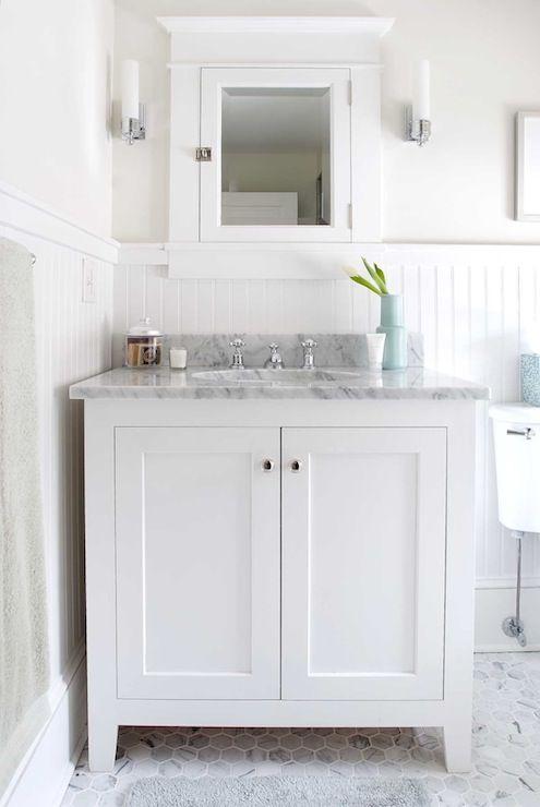Suzie: Papyrus Home Design - Cottage bathroom with glossy white beadboard walls backsplash, ...