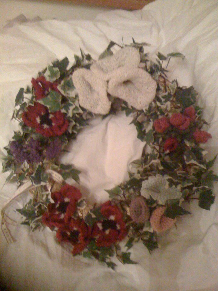 A bunch of us knitted the flowers for this wreath which