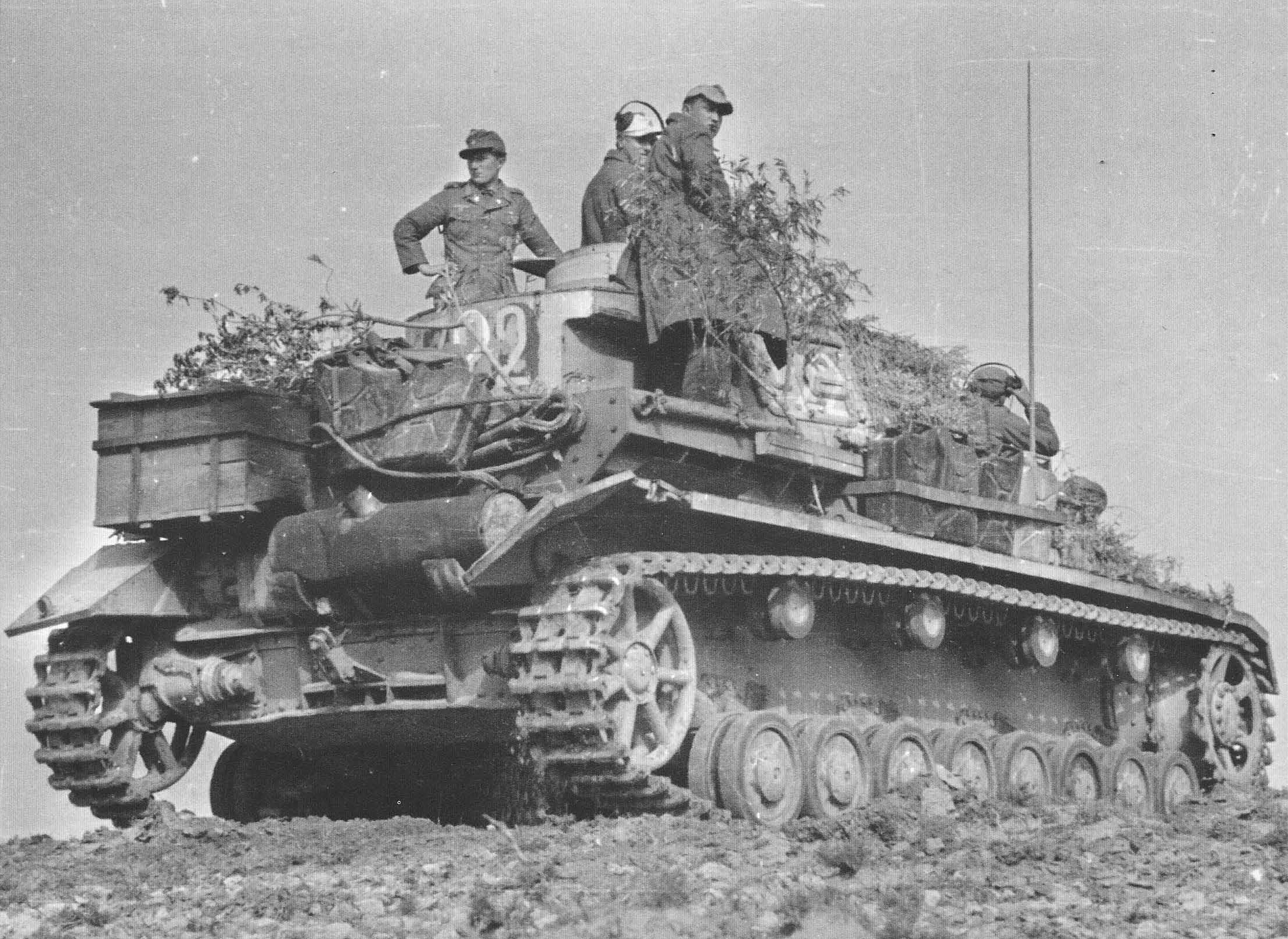 A Panzer 4 with it's crew while operating with the Afrika Korps