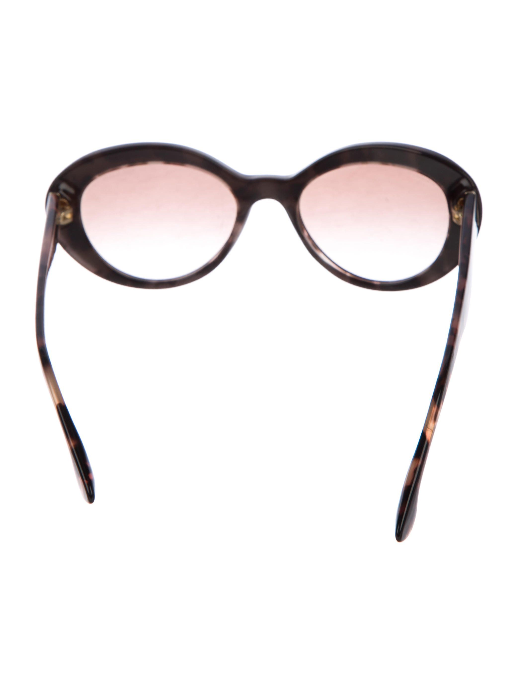 9753908dc843 Brown acetate Prada cat-eye sunglasses with tortoiseshell details at arms  featuring gold-tone accents and logos at temples and gradient lenses.