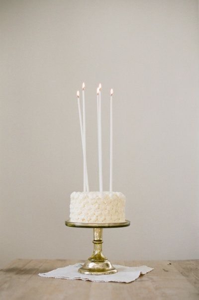 Long Thin White Candles On Birthday Cake