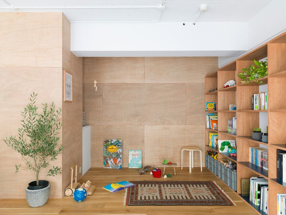 Domino Architects divides J House with wooden storage partitions ...