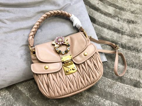 3d99c1217613 2018 Miu Miu Leather Coffer Bag in Cameo Beige Matelassé Leather ...