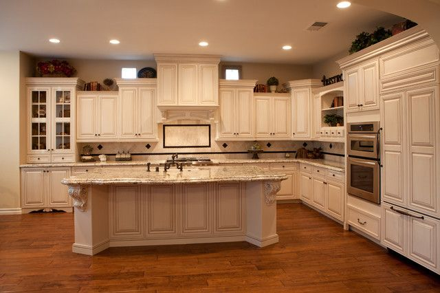 Upper Cabinets With Different Height Mediterranean Kitchen Orange County By Kitch Staggered Kitchen Cabinets Prefab Kitchen Cabinets Kitchen Remodel Cost