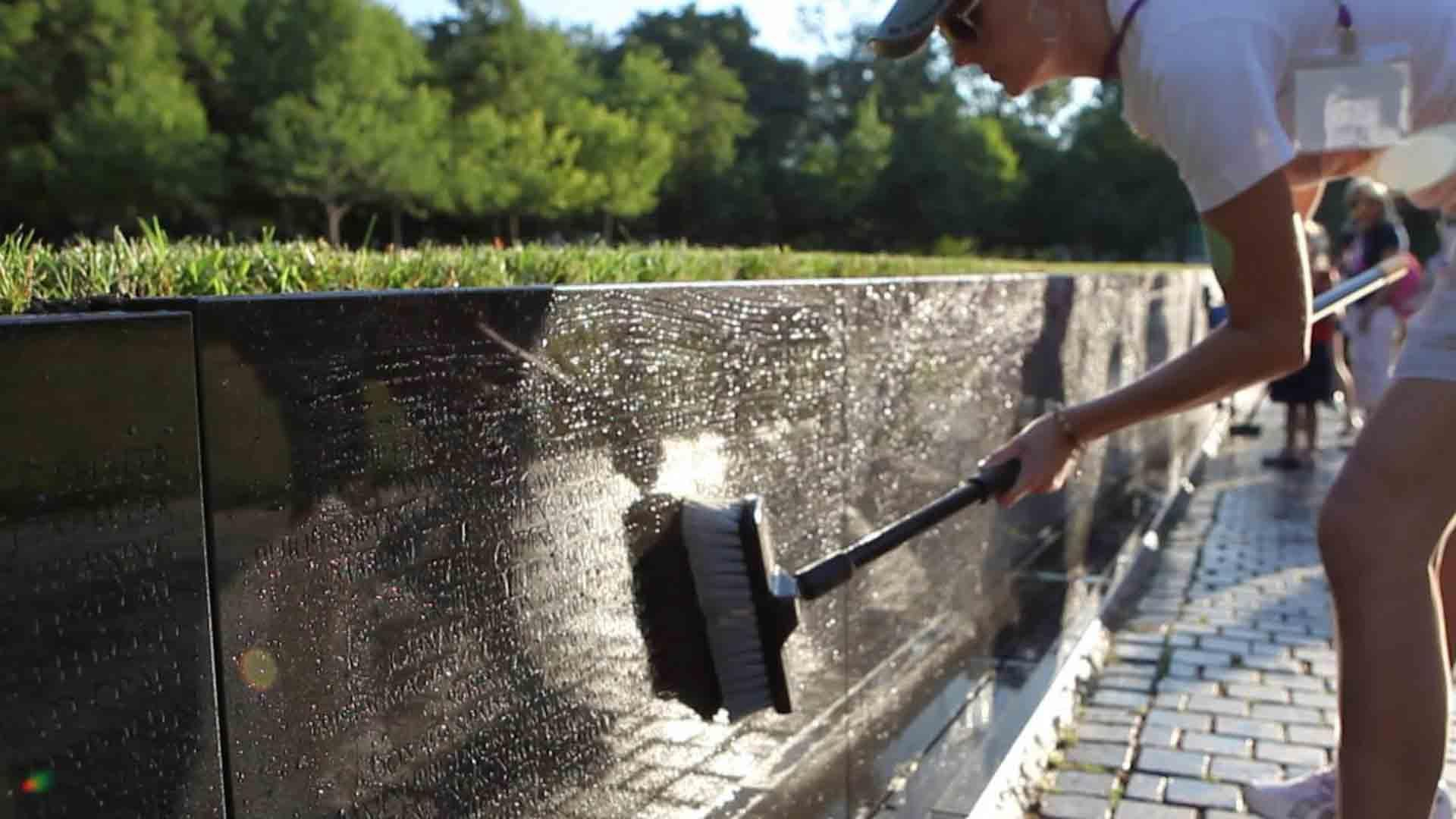 "Gold Star Children are committed to service. Members of Sons & Daughters In Touch meet every five years to wash ""The Wall"" at the Vietnam War Memorial. #MemDayPBS"