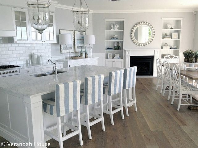White on White Coastal Kitchen with Blue and White Striped Barstools ...