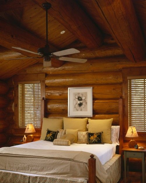 modern clean bedding sets off the log walls nicely log cabin