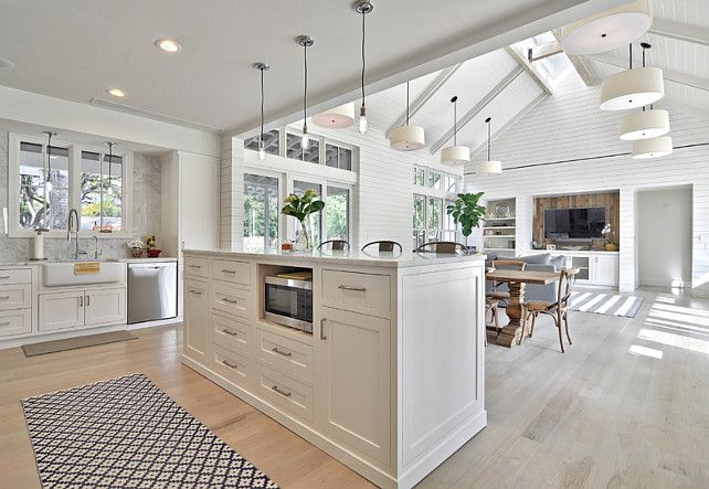 White Kitchen Open To Family Room open floor plan kitchen and family room with shiplap wall and