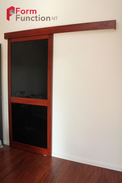 Top Hung Sliding Door with black glass and jarrah complimenting jarrah pelmet. & Top Hung Sliding Door with black glass and jarrah complimenting ...