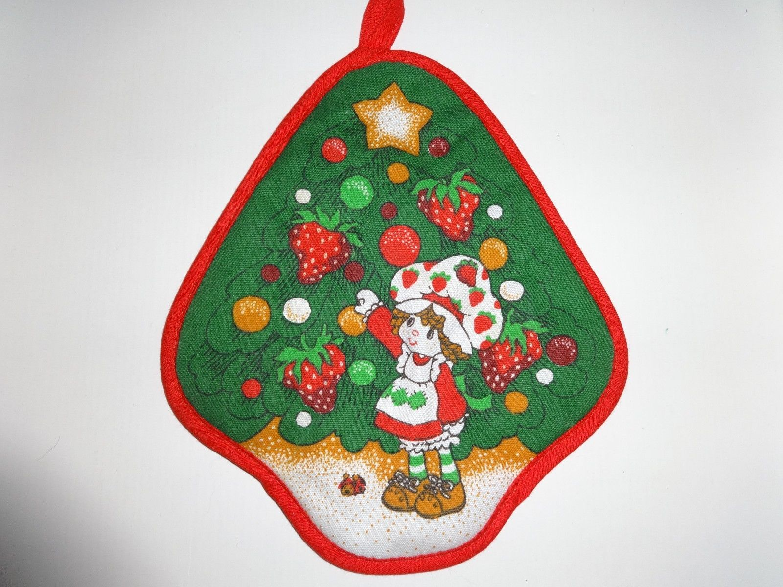 http://www.ebay.com/itm/STRAWBERRY-SHORTCAKE-Hot-Pad-VINTAGE-CHRISTMAS-1980-Pot-Holder-new-condition-/171444844059?pt=LH_DefaultDomain_0&hash=item27eae8b61b
