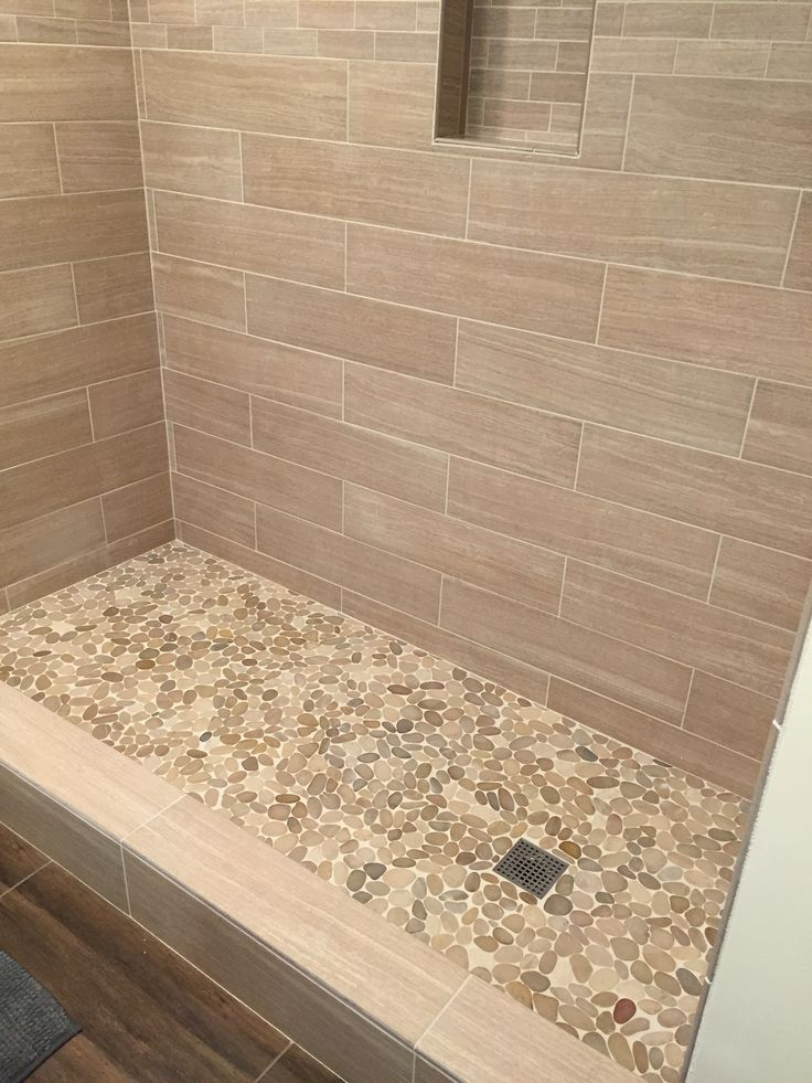 sliced java tan pebble tile shower floor. https://www