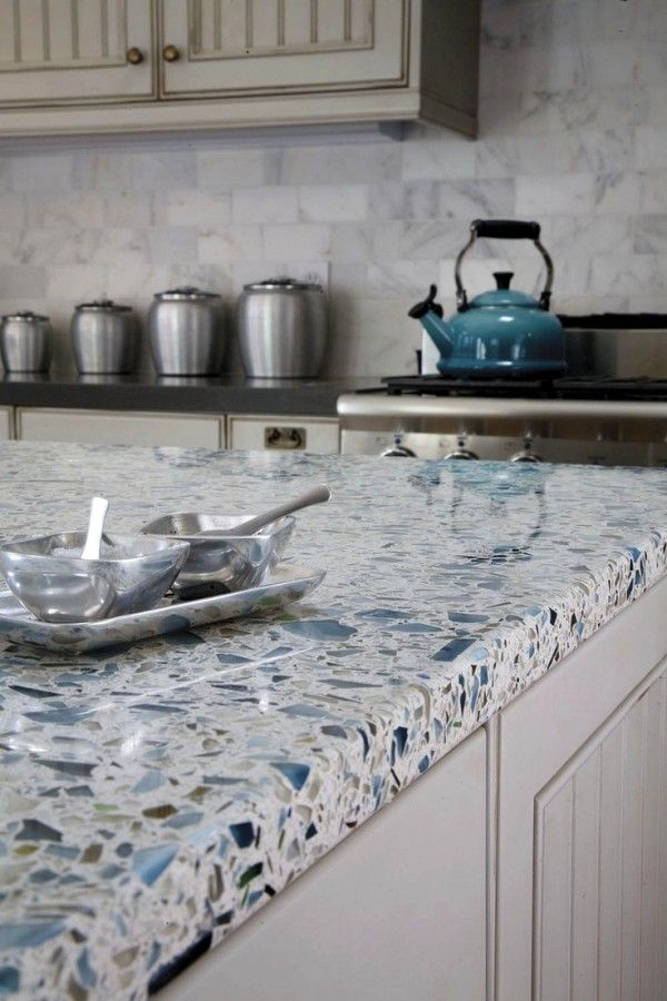 Recycled Glass Kitchen Countertops Kitchen ideas: recycled glass countertops, bead board cabinets, and  calacatta marble tile backsplash.