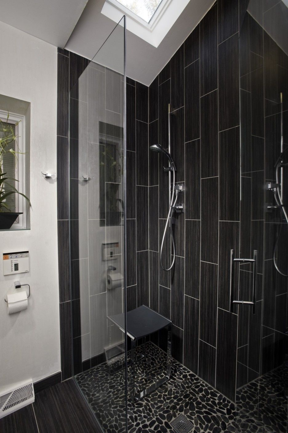 bathroom black vertical subway tile corner shower design with