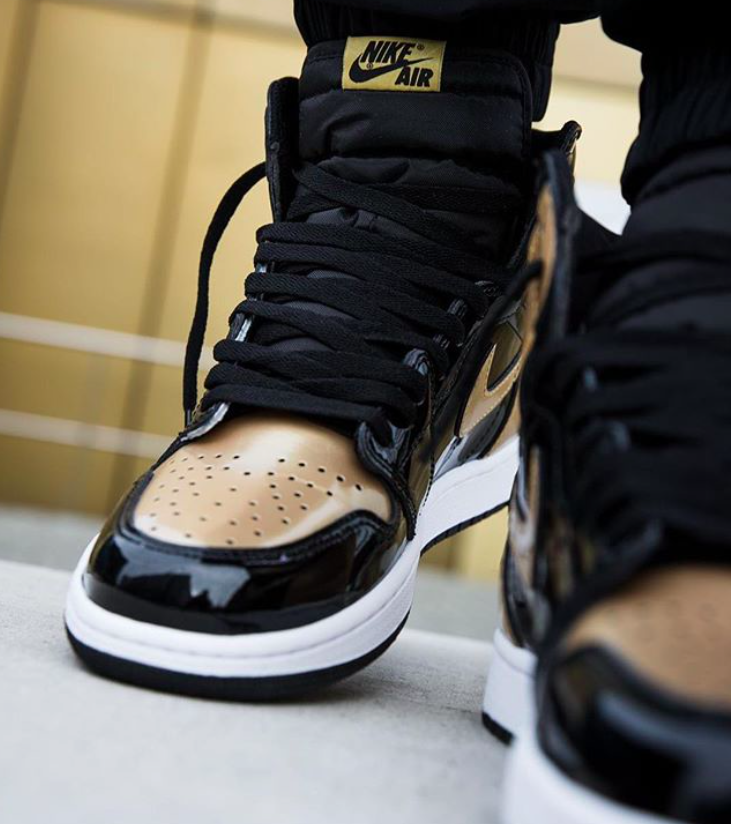 e08a97001cd The Air Jordan 1 Retro High OG Gold Toe is featured in a lifestyle look and