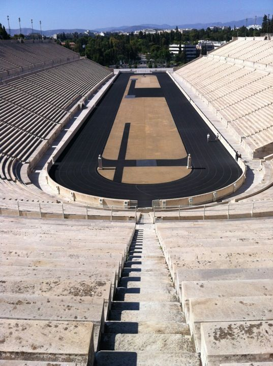 The Panathenaic Stadium is located on the site of an ancient stadium and for many centuries hosted games in which nude male athletes competed (gymnikoi agones) in track events, athletics championships as we would call them today. The games, which since antiquity had been held in an area far from the city, were included in the programme of the Panathenaia festival celebrations in 566/565 BC. When the orator Lykourgos assumed responsibility for the finances of Athens, in 338 BC, he included in…