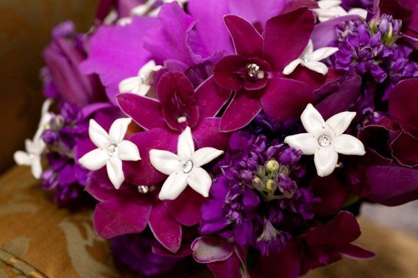 A purple-lover's dream!  Cattleya orchid, dendrobium orchids, stock, roses, stephanotis