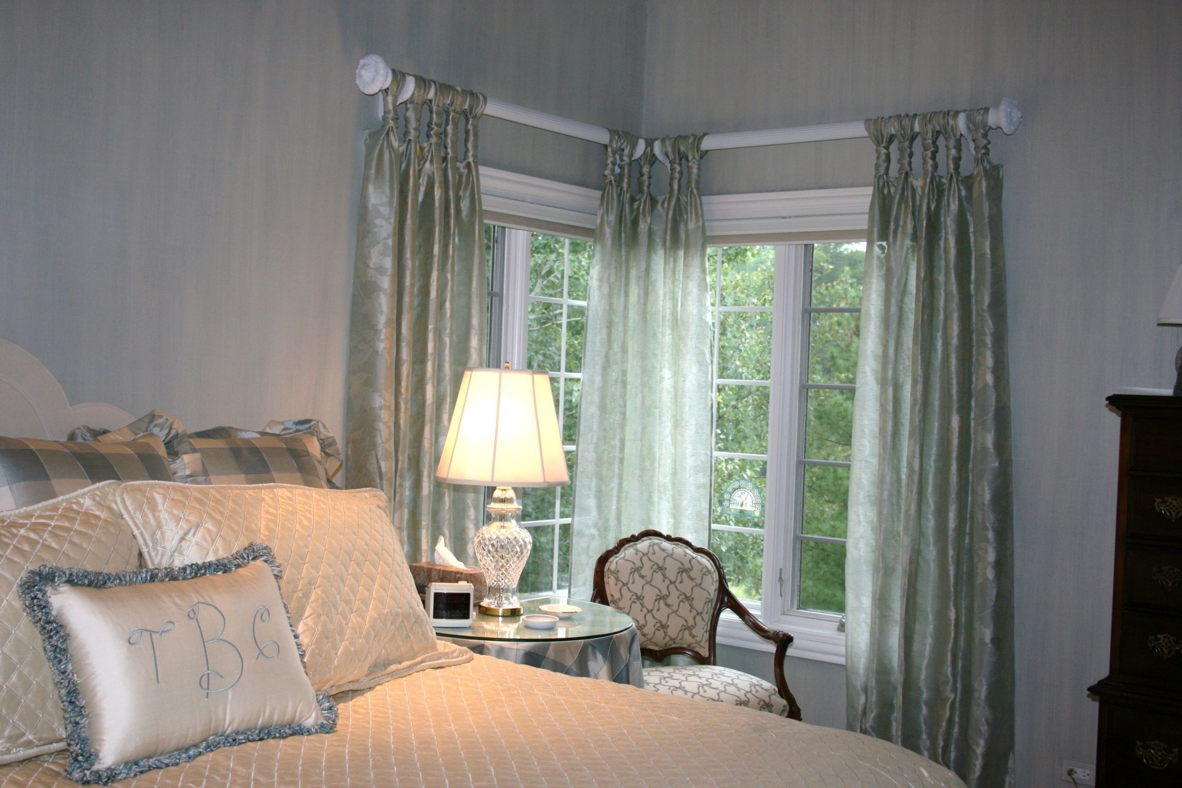 Cinch top sheer drapery panels for a master bedroom