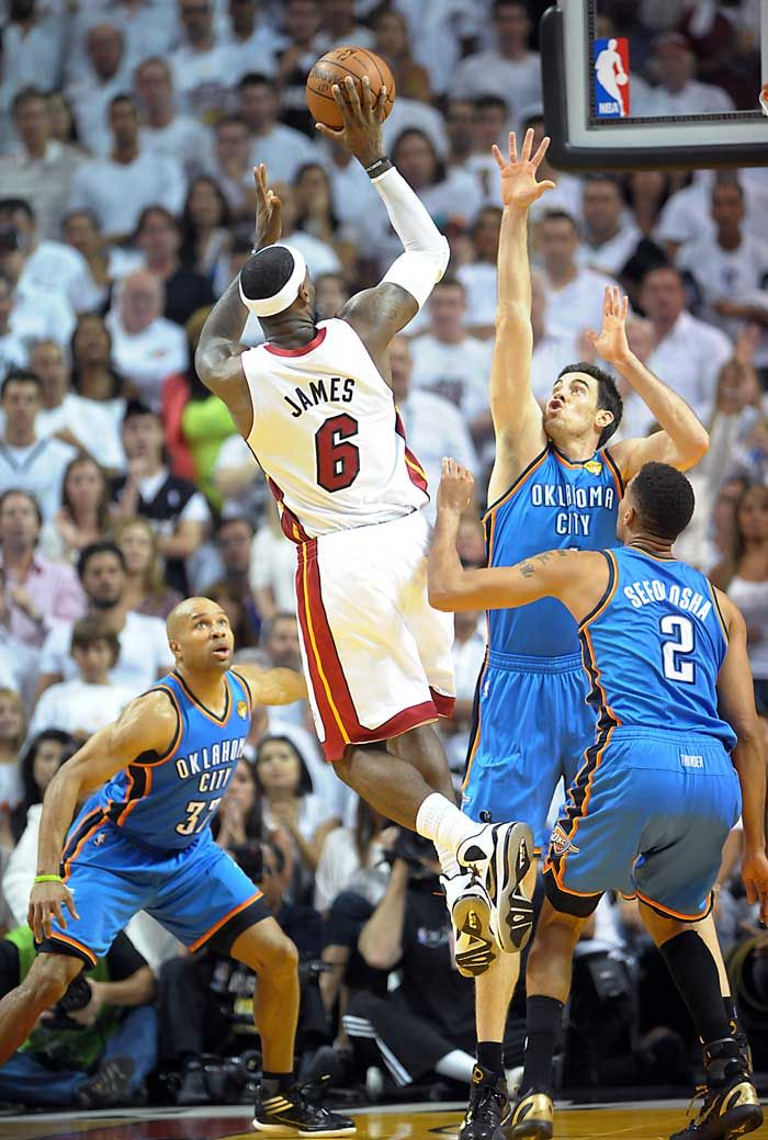 Miami Heat's LeBron James takes a shot over Oklahoma City Thunder's Nick Collison during the third quarter in Game 3 of the NBA Finals at the AmericanAirlines Arena in Miami, Florida on Sunday, June 17, 2012.  (Robert Duyos, Sun Sentinel)