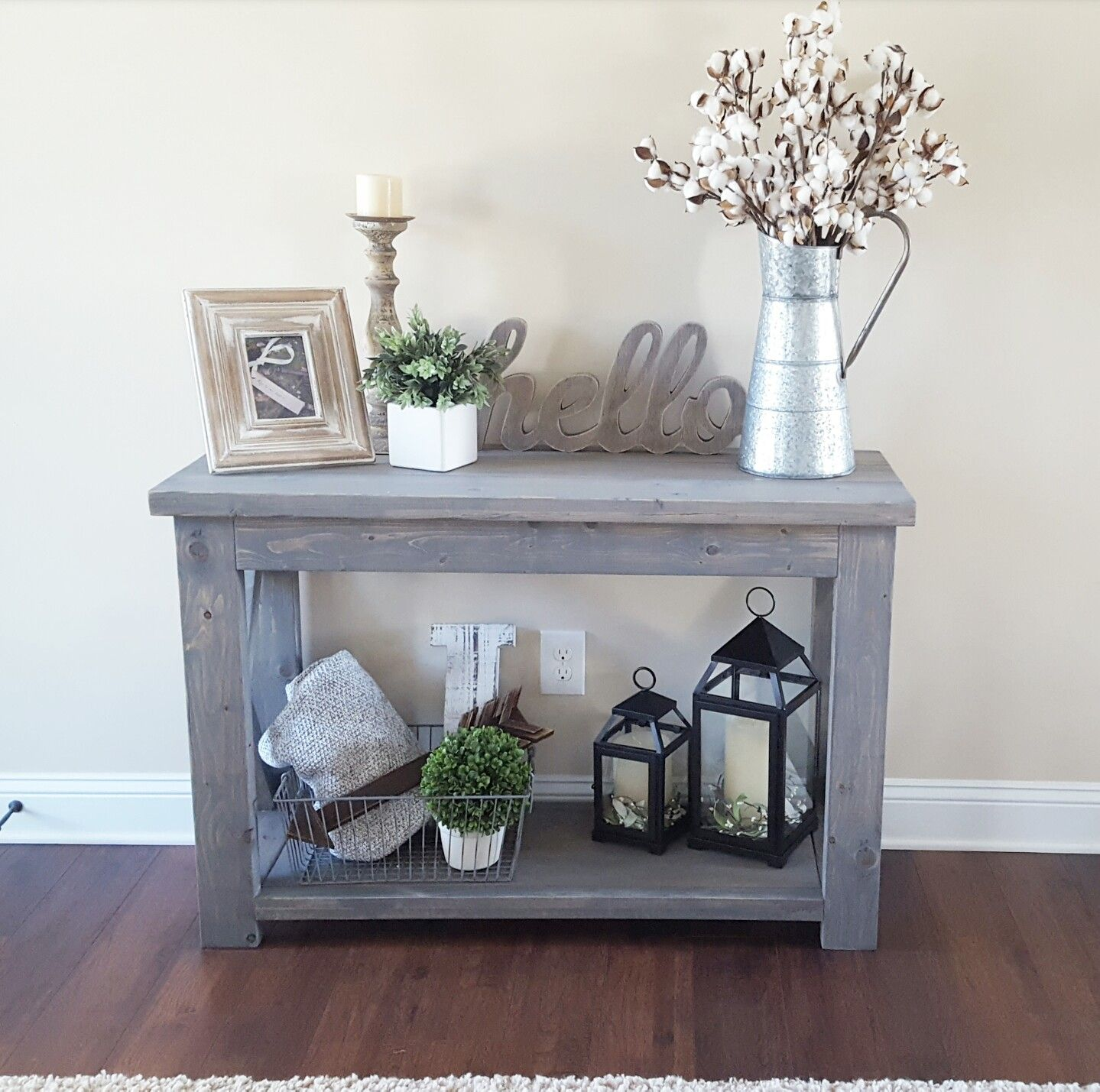 modified Ana White's Rustic X Console table, and used