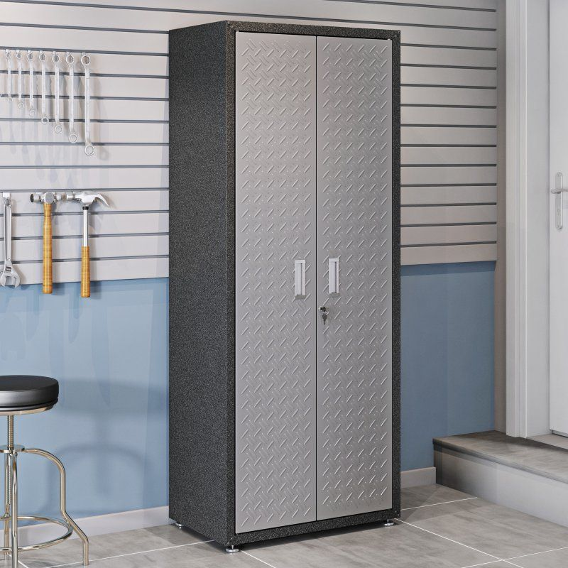 Manhattan Comfort Fortress Tall Textured Metal Garage Cabinet is part of Metal cabinet Texture - Dimensions 30 3W x 18 2D x 74 8H in   Made of textured steel  Gray and dark gray finish  2 doors and 3 adjustable shelves  Locking doors with key  Recessed handles  Floor levelers  Assembly required, hardware included  Use the Manhattan Comfort Fortress Tall Textured Metal Garage Cabinet to keep your garage work shop tidy  Its three adjustable shelves offer customized storage and are tucked behind double, locking doors  This garage cabinet is built of textured steel in a gray on dark gray finish that won't show grime  Floor levelers ensure stability