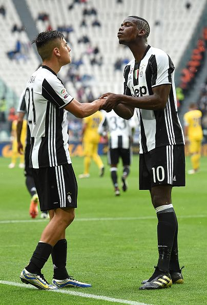 88c3433924d Paulo Dybala of Juventus FC celebrates after scoring his goal from the  penalty spot with team mate Paul Pogba during the Serie A match between.