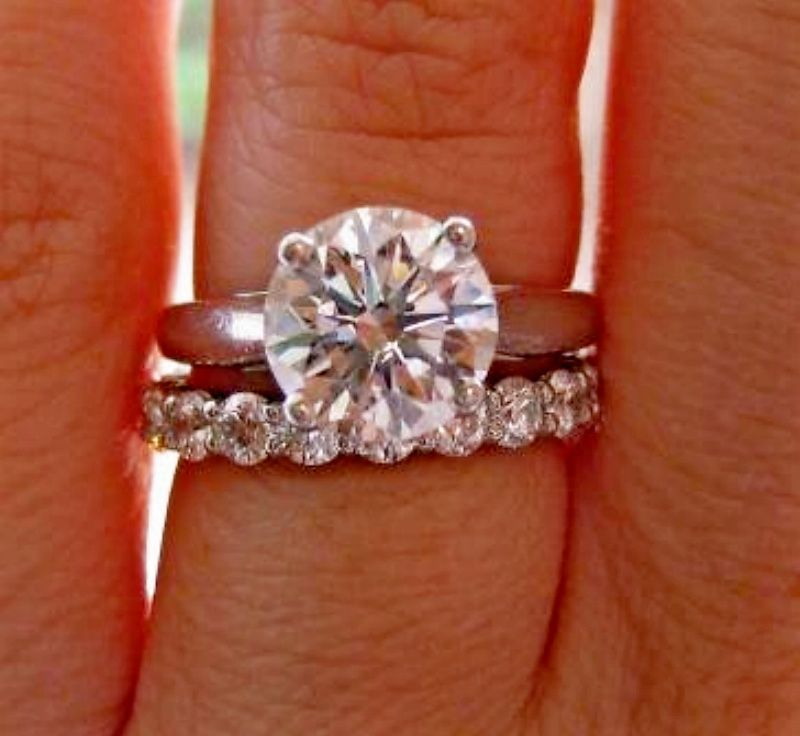 The diamond wedding band perfectly pliments the solitaire diamond engageme