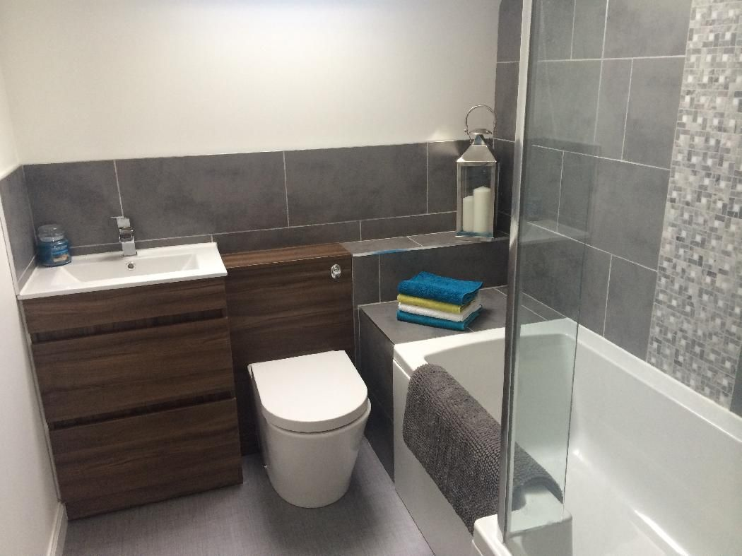 This walnut bathroom furniture looks great against the grey tiles by ...
