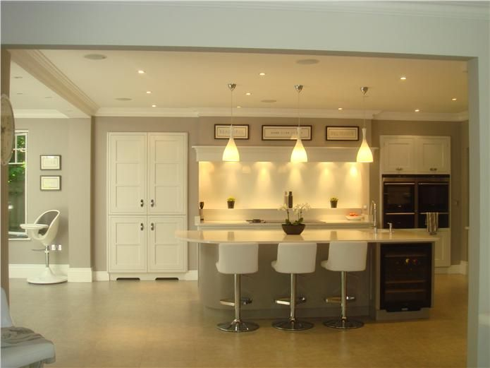 Cream Painted Kitchen Units With Polished Pebble Walls