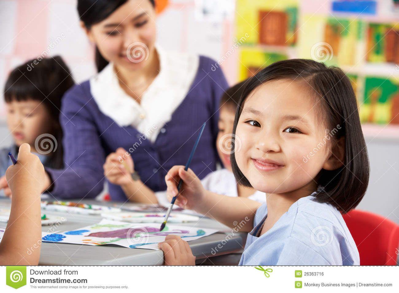 Female Pupil Enjoying Art Class In Chinese School Royalty Free ...