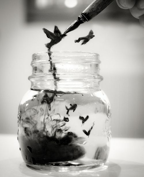 I think the creatures in the jar could symbolize being reborn, because they are being created out of the ink. Even though these creatures are artificial they create an interesting in the image.