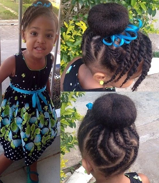 Cornrow bun hairstyle with a twisted side bang