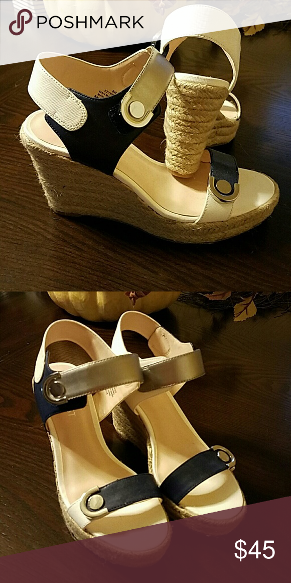 Wedge sandals Get a head start on spring & summer shopping!!Very cute navy blue, silver & white strappy wedge. New, never been worn. Nine West Shoes Wedges