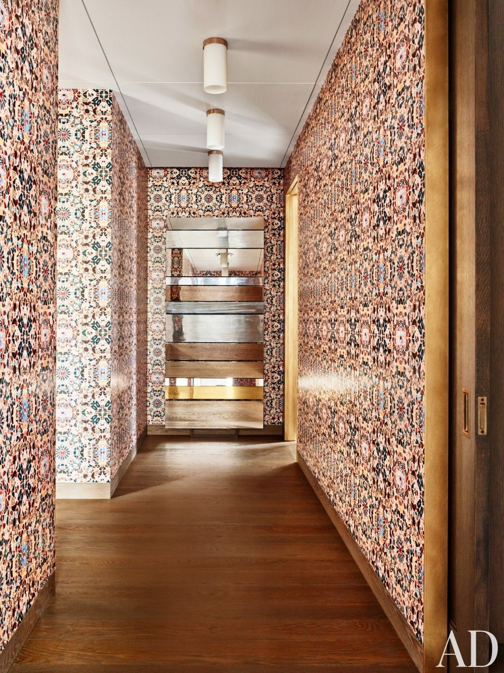 Hallway and stairs wallpaper  Damien Hirst wallpaper lines a hallway by Dufner Heighes in New York