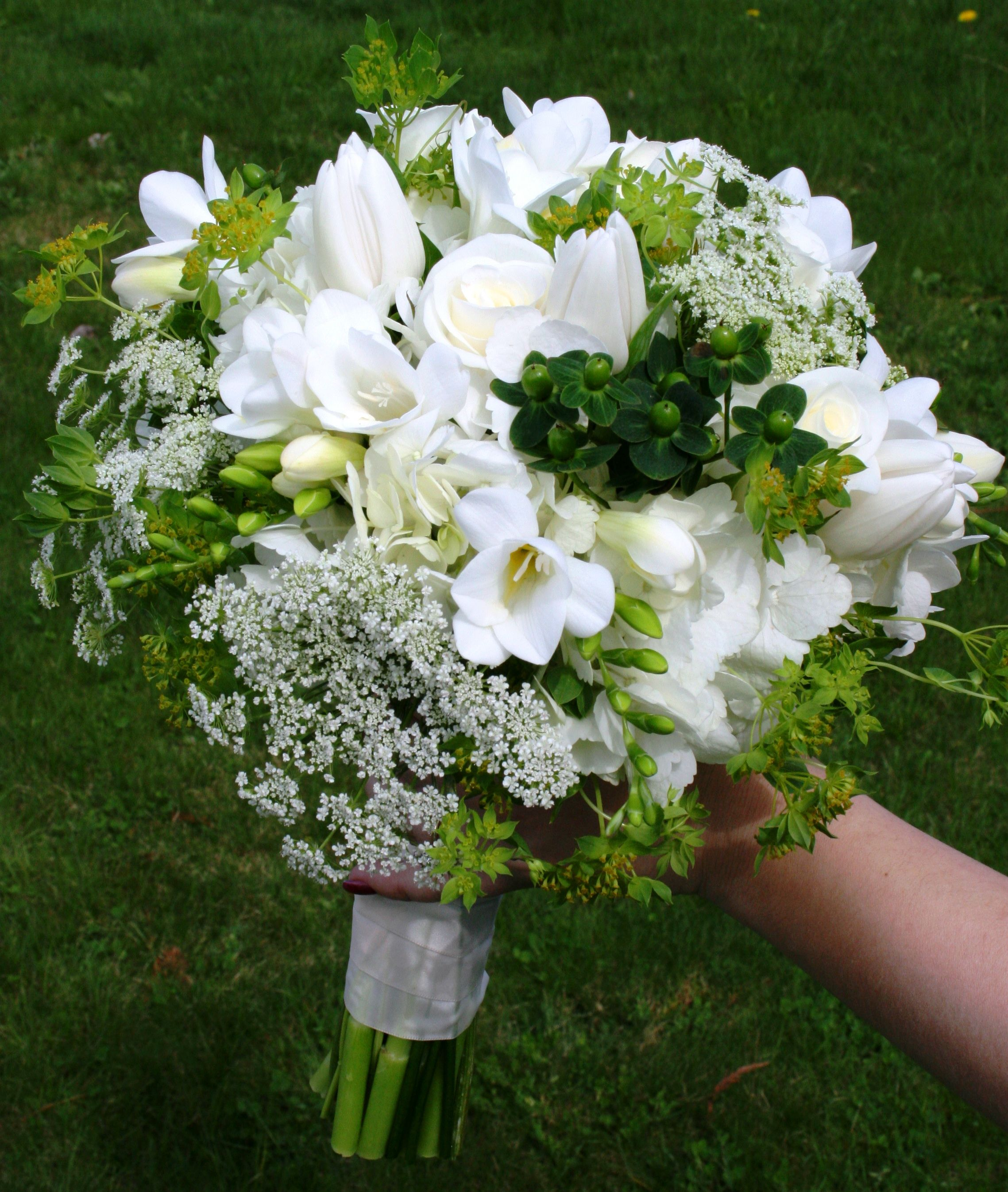 Bridal bouquet of white roses queen annes lace green and white white flowers and green berries dhlflorist Image collections