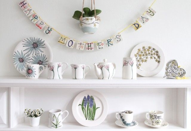 Lovely personalised pottery from Gallery Thea.  Those are our square ceramic plaques used as bunting.