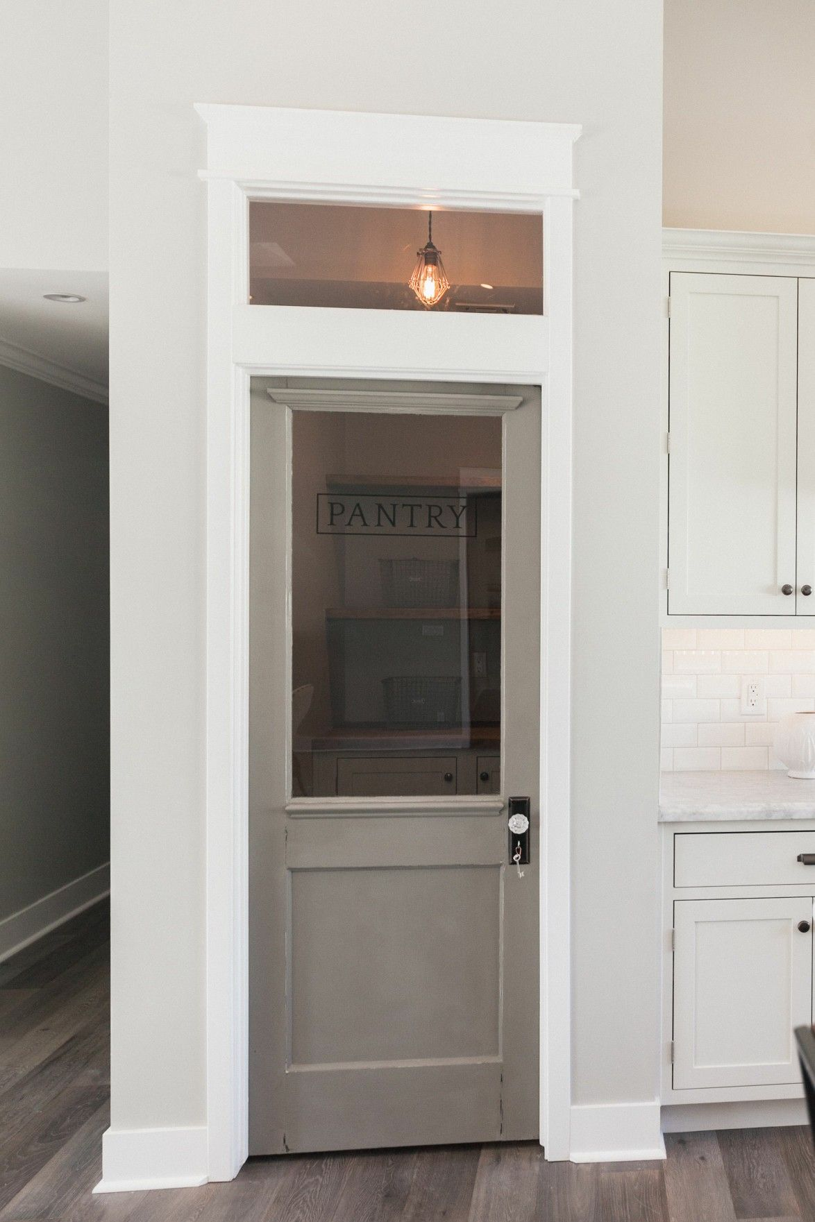 Pin by ingrid alexandria on home pinterest future for the laundry room pantry door transom window love the white woodwork gray door and crystal door knob planetlyrics Images