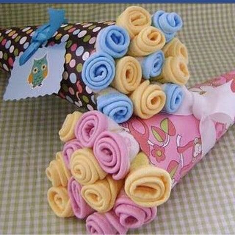 Sock flowers babyshower ideas pinterest socks and babyshower bouquet of onesies burpcloths swaddling blankets great gift idea for baby shower possible idea for my sisters baby shower negle Image collections