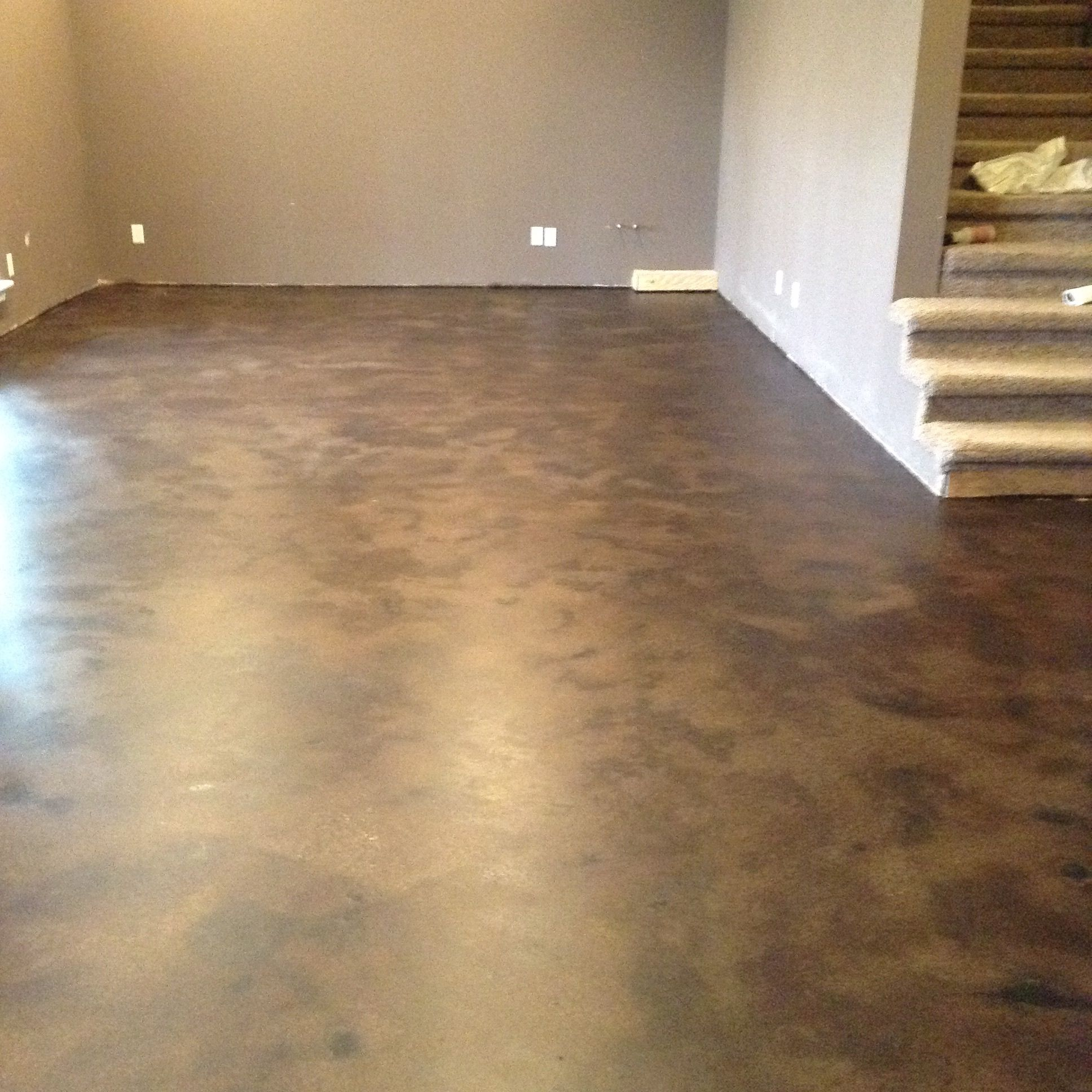 Basement stained concrete floor used as an entertainment for Stained concrete floors