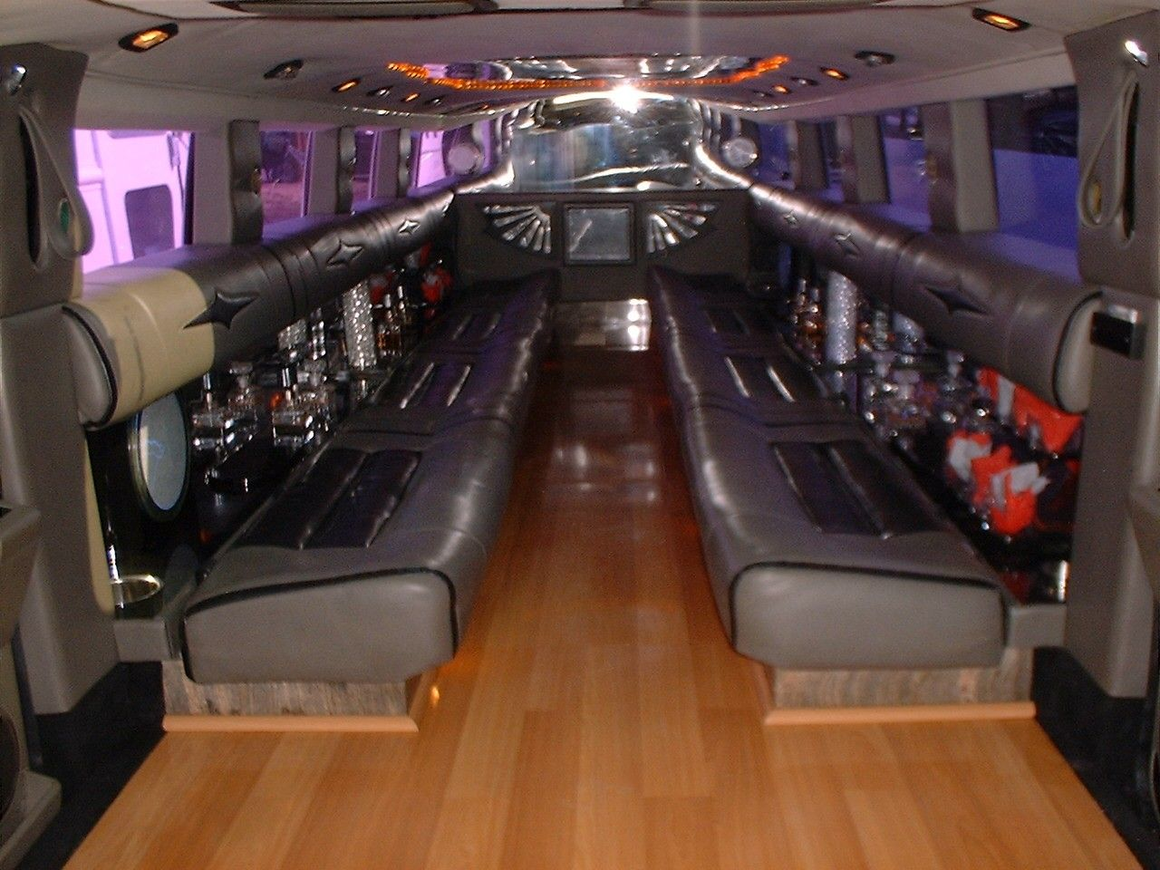 Custom limousine bus interiors our fleet li vineyard for Custom party bus interiors