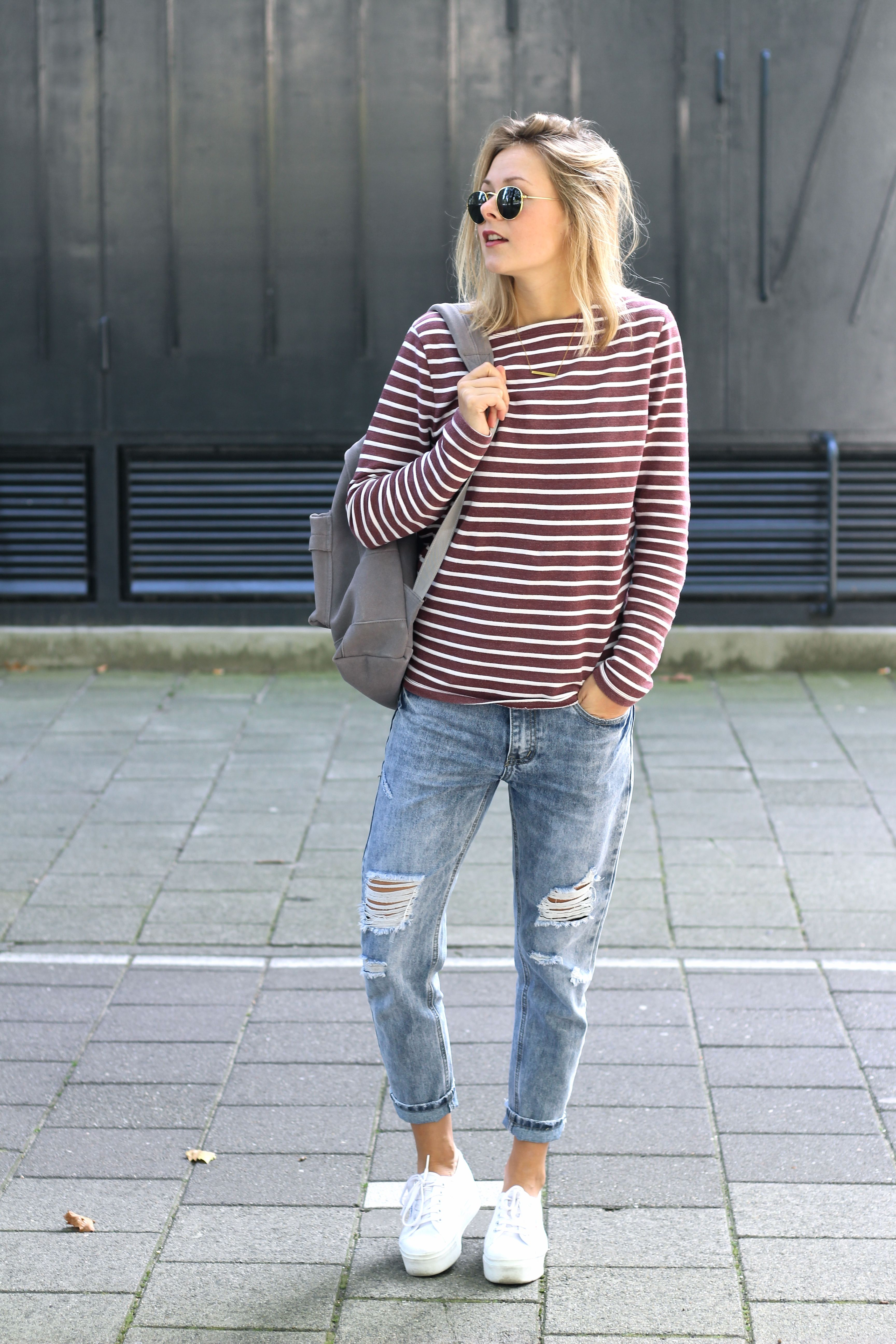 maroon and white striped shirt  ripped boyfriend jeans