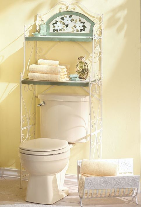magnolia bathroom shelf a genteel way to add storage to tight quarters these space saving shelves fit snugly over the toilet to make a decorative home for - Bathroom Cabinets That Fit Over The Toilet