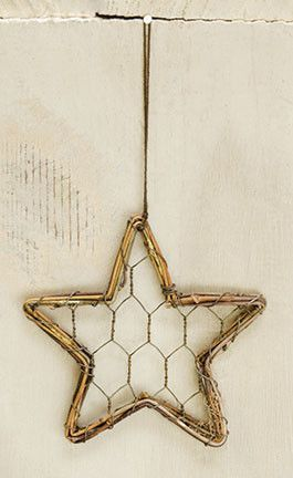 Wire/Vine Star Ornament is star shaped and made of chicken wire and real vine. It is 4inches in diameter.