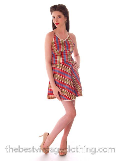 Sweet vintage swimsuit or bathing suit of a bright tartan plaid taffeta, with red cotton knit panty and lining the whole suit. It has criss-cross back ties and a back button closure. I love skirted ba