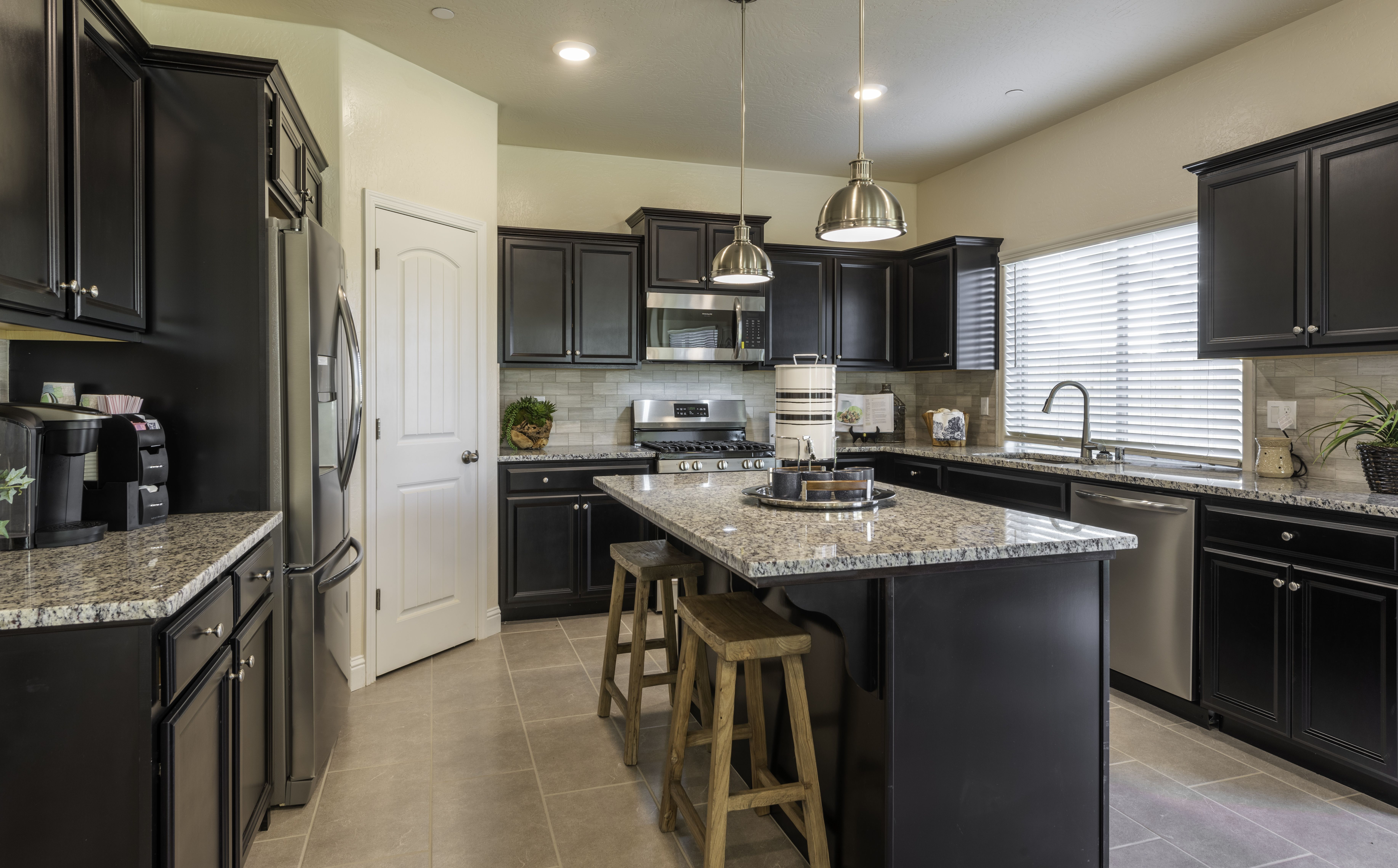 Modern Kitchen With Dark Wood Cabinets Granite Counter Tops And Neutral Subway Tiles Included With Kitchen Island And In 2020 New Homes For Sale New Homes Flex Room