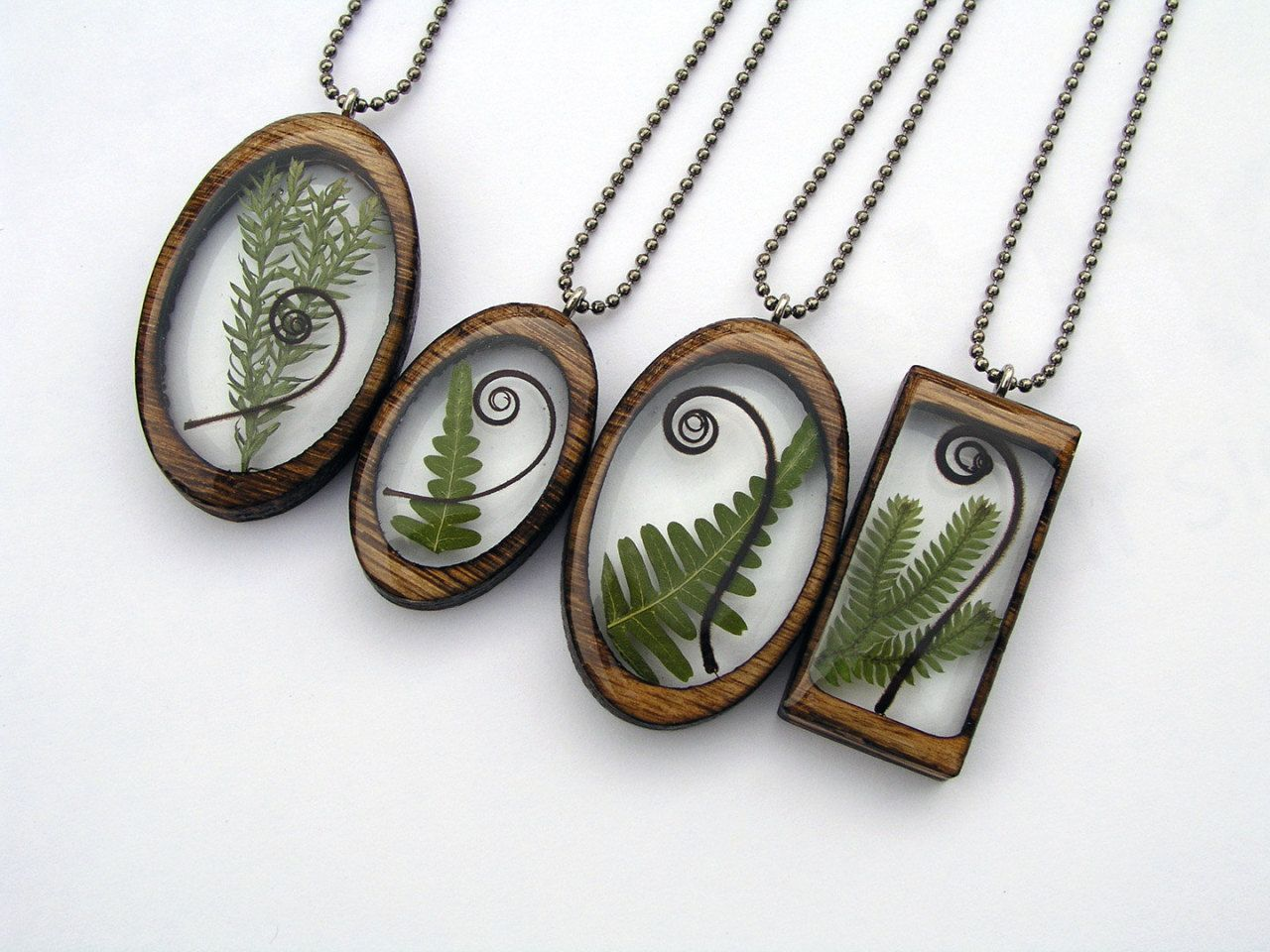 Resin and wood pendants by BuildWithWood on Etsy Resin
