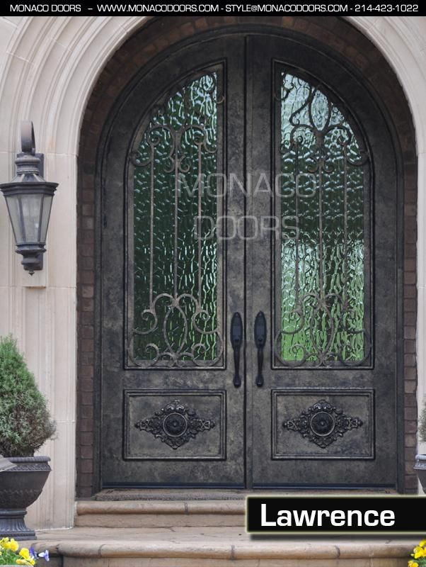 Arched Double Front Doors monaco doors (while i don't particularly care for the iron work on