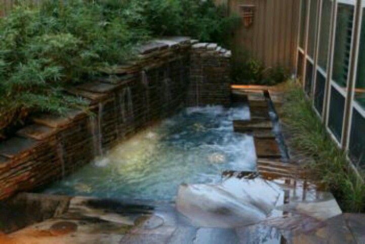 Waterfall over stacked stone hottub dream house pinterest - Sognare piscine ...