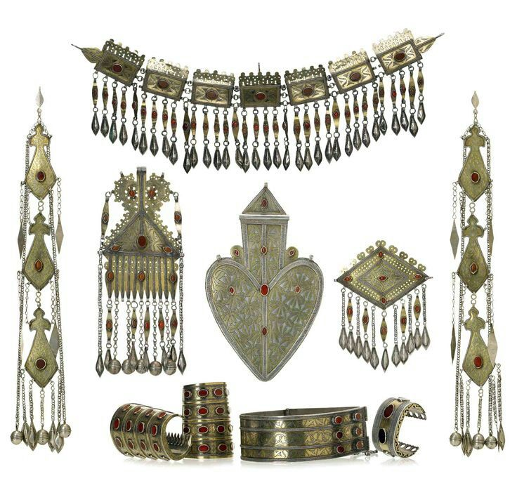 suzani:  Central Asia, Turkomen jewelry wedding set (10 pieces); silver, silver gilt and carnelian; ca. early 1900.